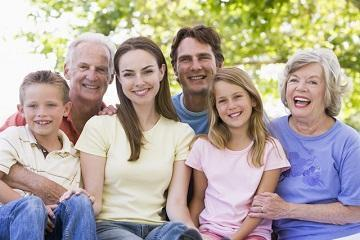 young family with grandparent smiling brightly I family dentistry in wilmington de