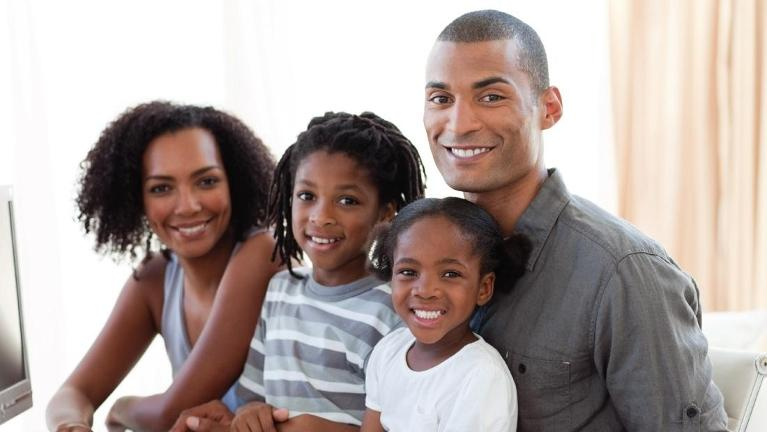 Young family smiling | Wilmington DE Dentist