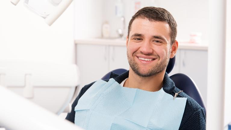 A man smiles in the dental chair | dental x-rays wilmington