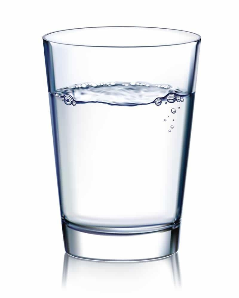 A glass of water infront of a white backdrop | Wilmington DE Dentist