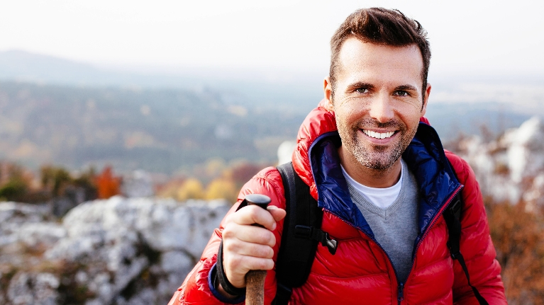 wilmington de dentist | a smiling man with a hiking stick